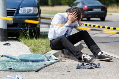 Frustrated man getting worried of the car accident.
