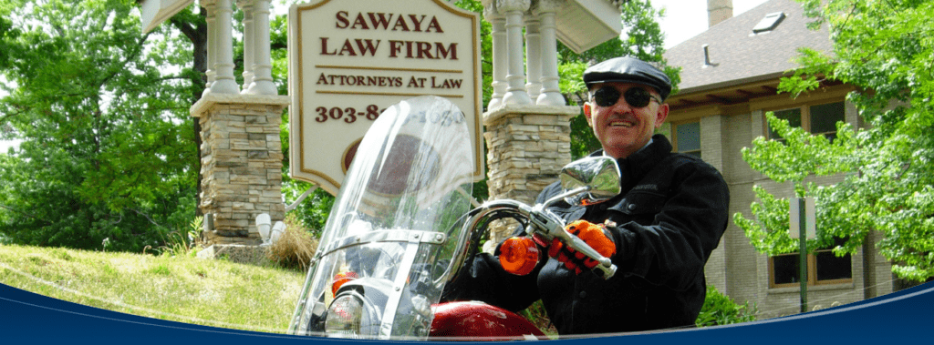 Denver motorcycle attorney, Mike Sawaya, rides his new motorcycle around the city.