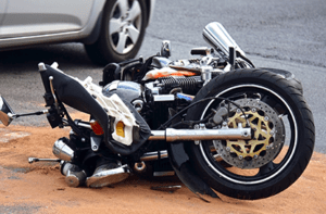 Motorcycle crashed on a street in Denver, Colorado.