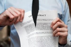Our Denver employment lawyer tearing an employment contract