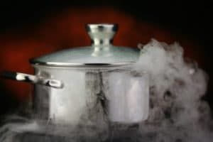 Steam over cooking pot on a red background.