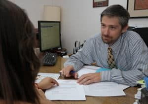 A personal injury lawyer in Thornton, CO talking with a client.