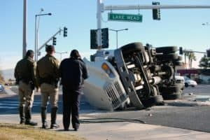 Police officers investigating truck accident in Denver.