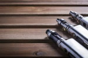 Different variety of electronic cigarette or e cig over a wooden background.