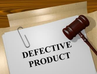 Defective product paperwork on the desk of a Denver product liability lawyer.