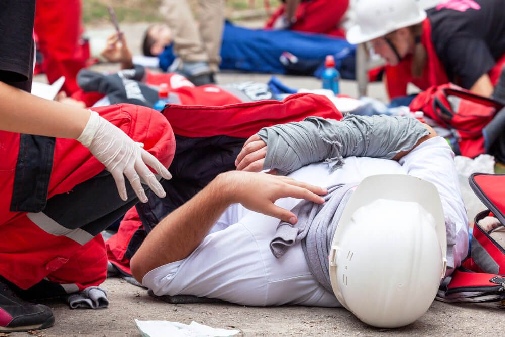 Injured worker at the construction site.
