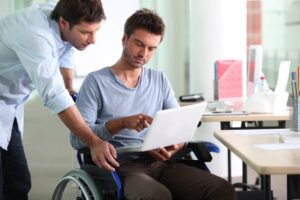 Disabled patient talking to his doctor for consultation.