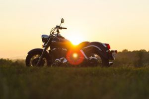 motorcycle in a field with Georgia sunset