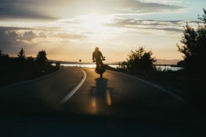motorcycle on road by water