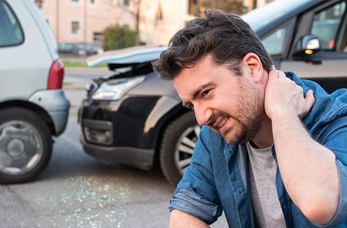 Man holding neck after a car accident