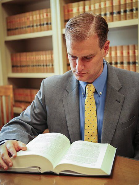 Ted Spaulding with law book