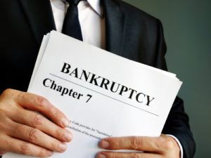 chapter 7 bankruptcy lawyer holding paperwork