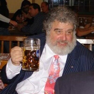 FIFA official Chuck Blazer enjoys a beer and a pinstriped suit.