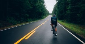 bicycle on road with trees