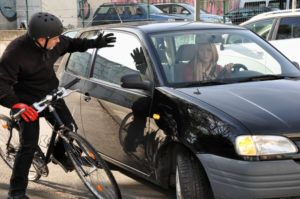 Bicycle rider almost got hit by car.