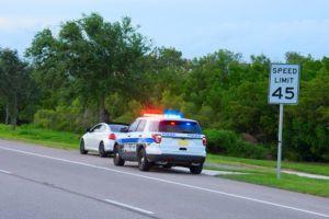 Driver stopped by police for over speeding limit.