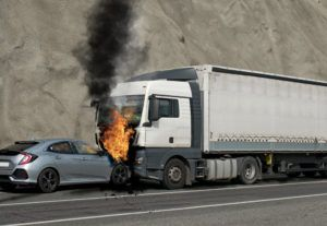 Truck burning along the highway.