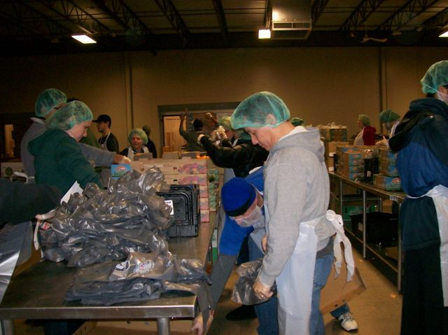 Our attorneys packing food for the hungry.