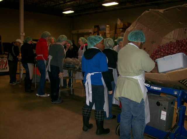 Our wonderful staff, packing potatoes.