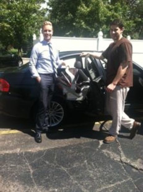 Attorney Brandon Hewitt and Jon ONeill during car seat safety inspection
