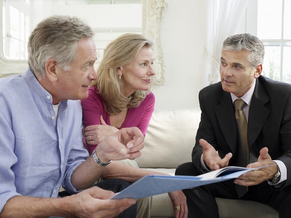 Couple consulting real estate lawyer regarding their trusts.