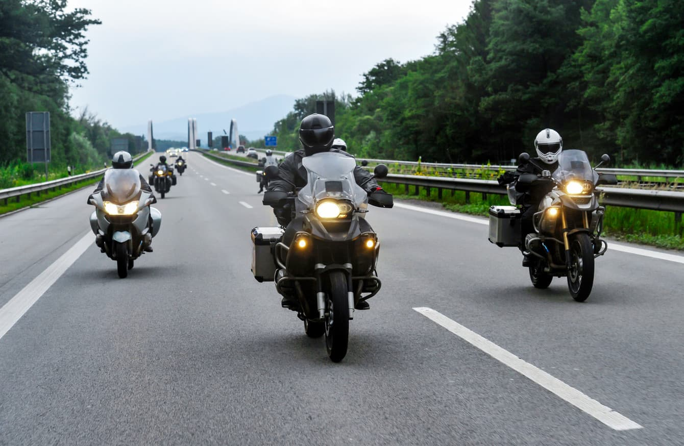 Motorcycle riders convoy pass through the highway.
