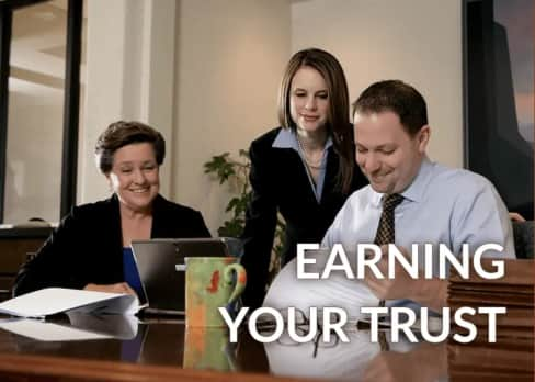attorney with clients earning your trust