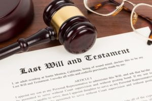 Last will and testament with gavel on top.