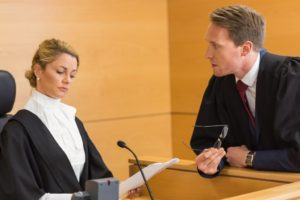 Lawyer talking to judge in the courtroom.