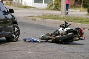 Motorcycle accident in the middle of the road.