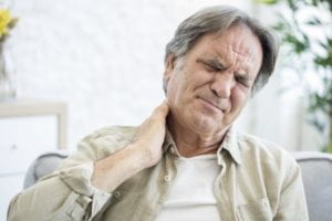 Man suffering neck pain from accident.