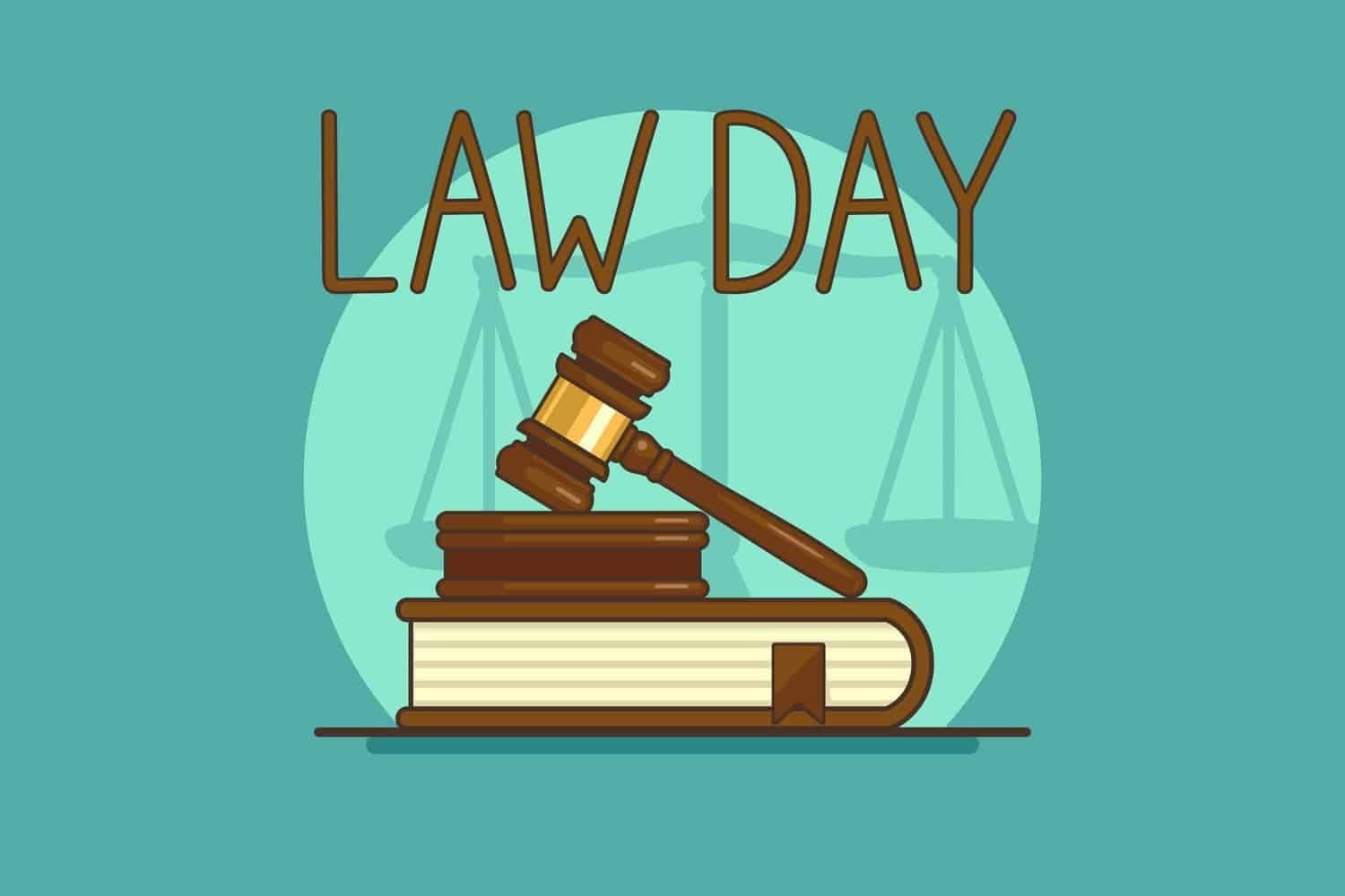 A Law Day sign above a judge's gavel and a book.