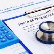 Health insurance claim form and medical bill, with calculator.