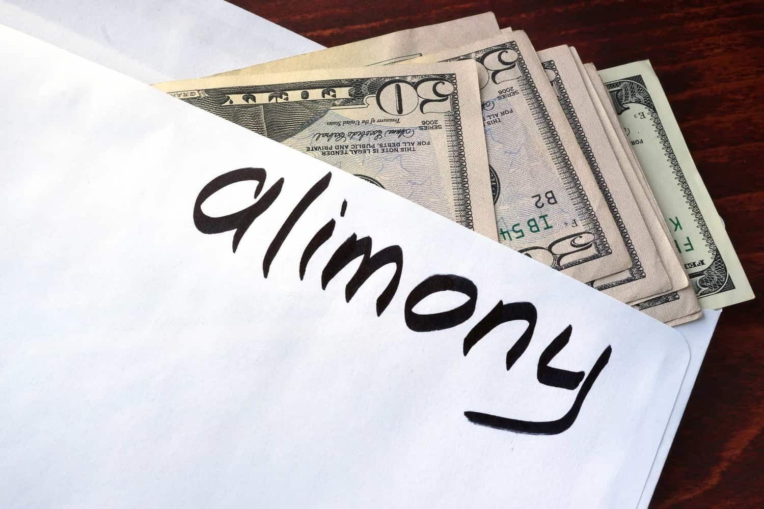 "Envelope filled with cash and ""alimony"" written on the front."