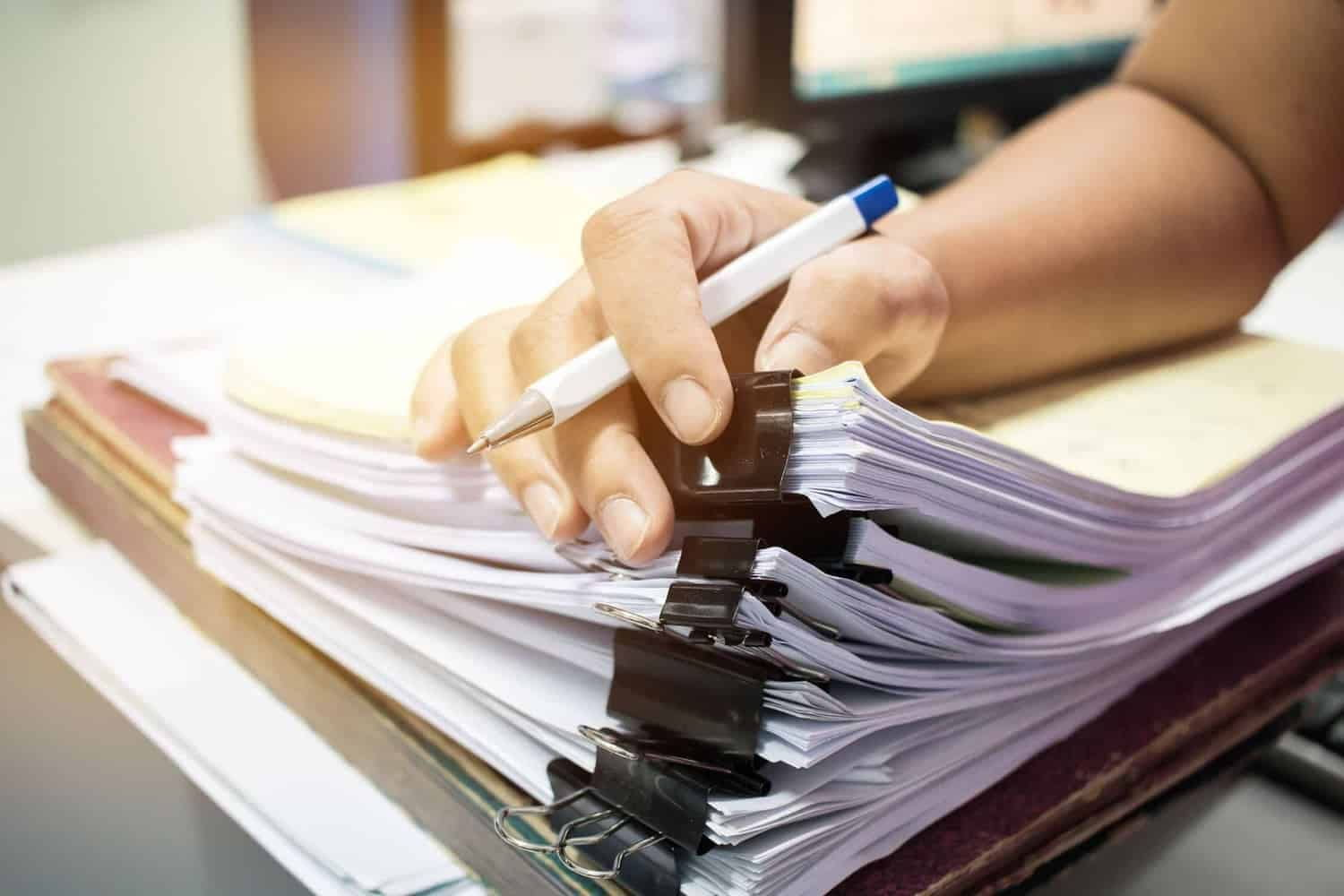 Person sorting through important documents
