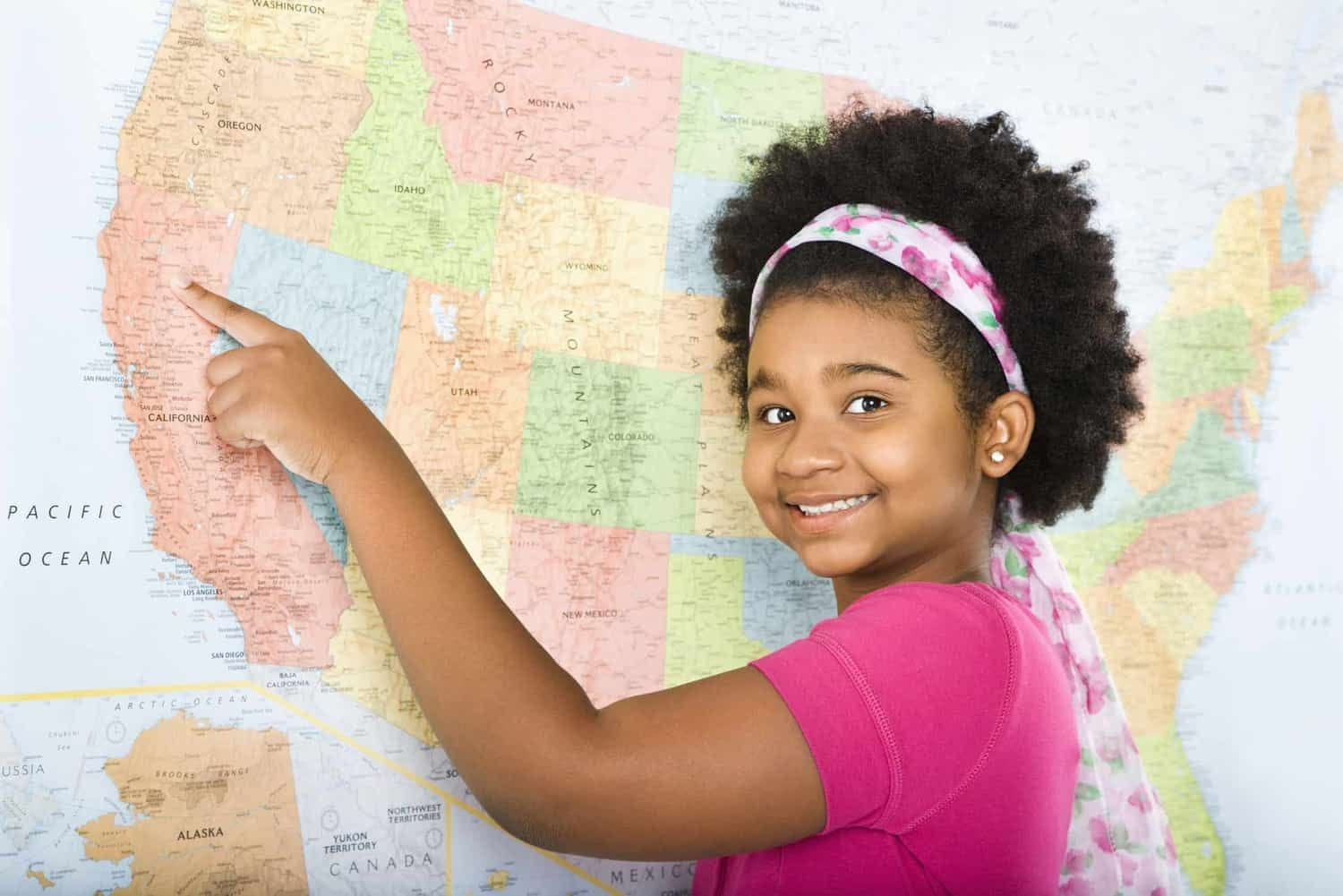 Girl pointing to map of the United States