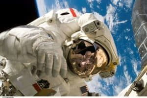 Astronaut spouse charged with perjury