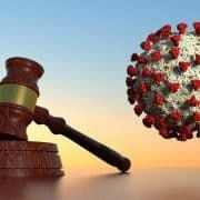 A judge's gavel next to an image of Coronavirus.