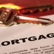 House keys on top of a mortgage document.