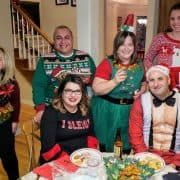 Graham.Law staff wearing ugly sweaters for 2018 holiday party.