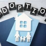 Adoption, family in front of house