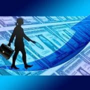 Business woman superimposed on stack of money