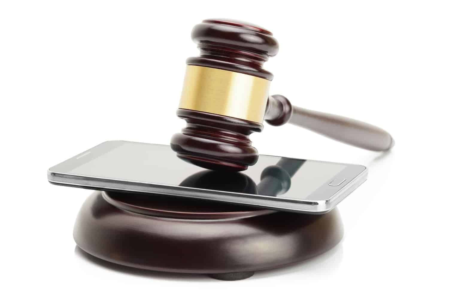 Gavel on top of mobile phone