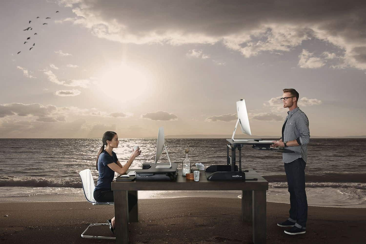 Man & Woman working in remote office on the beach