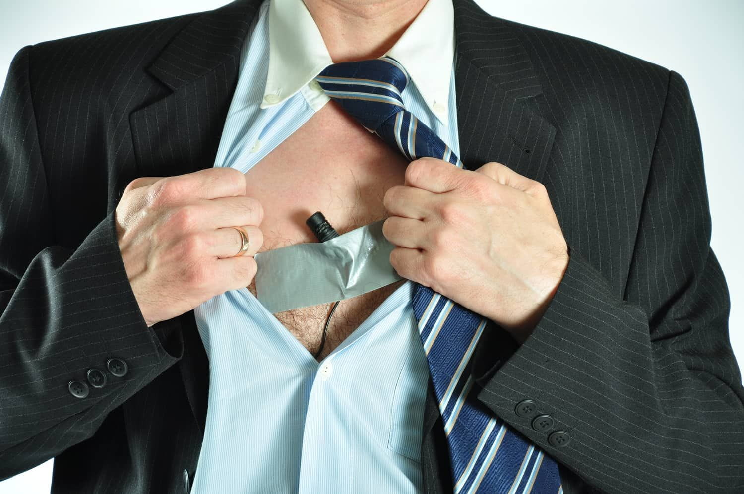 Man with hidden microphone taped to chest