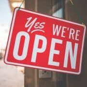 Red Yes We Are Open Sign outside business