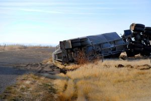 Car wreck of semi truck trailer rolled over