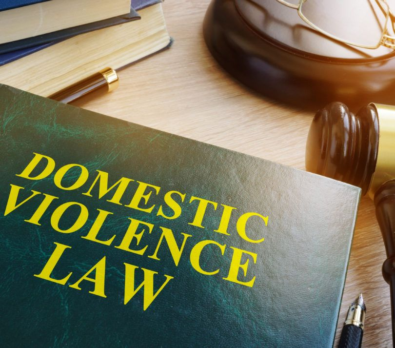 domestic violence law on wooden table