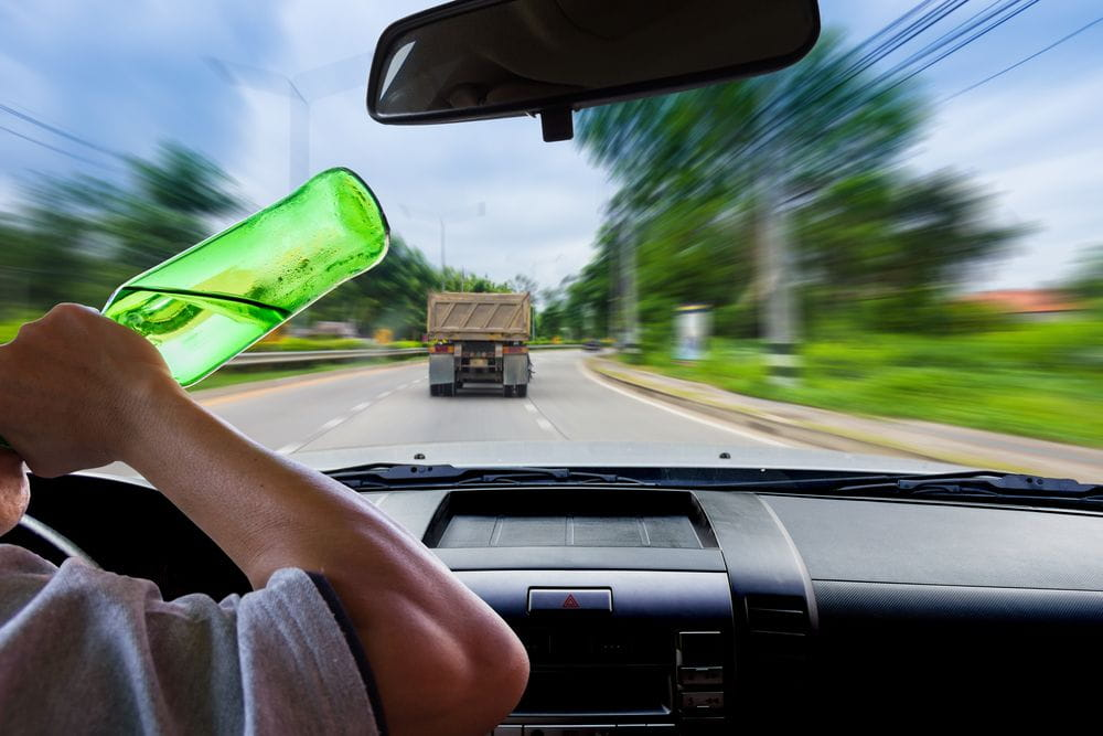 Truck driver drinking alcohol while driving