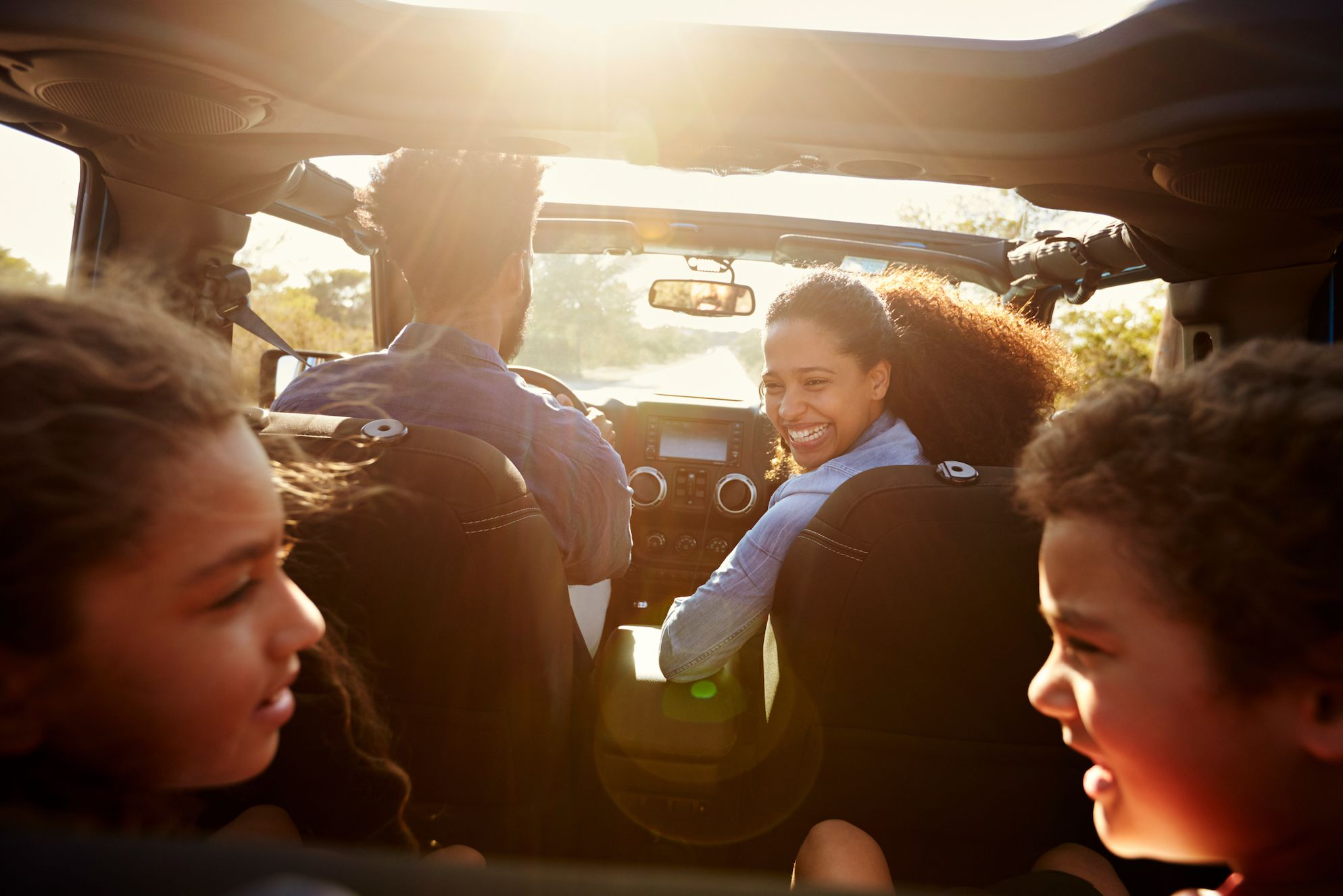 children with family in car